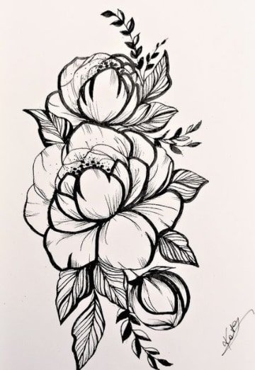 flowers for woman bicep tattoo idea