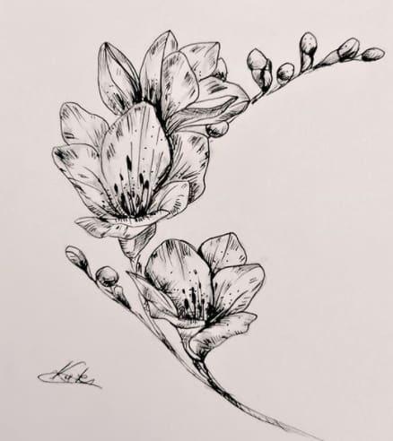 flowers bicep tattoo idea