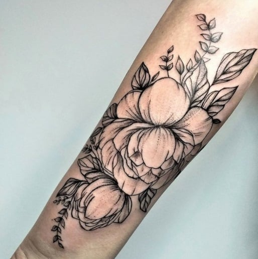 flowers on arm black ink tattoo