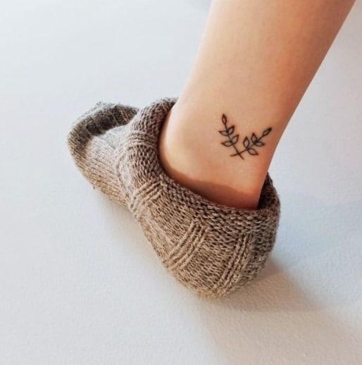 leafs on ankle black ink tattoo