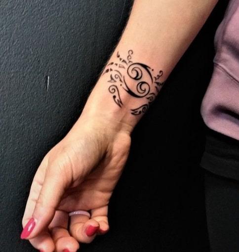 zodiac cancer on wrist black ink tattoo