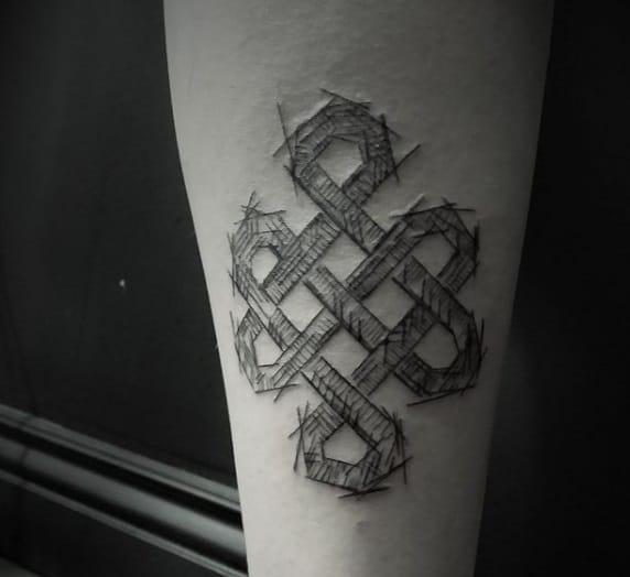 infinity knot design calf tatto