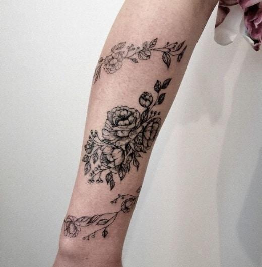 flower bracelet forearm tattoo idea