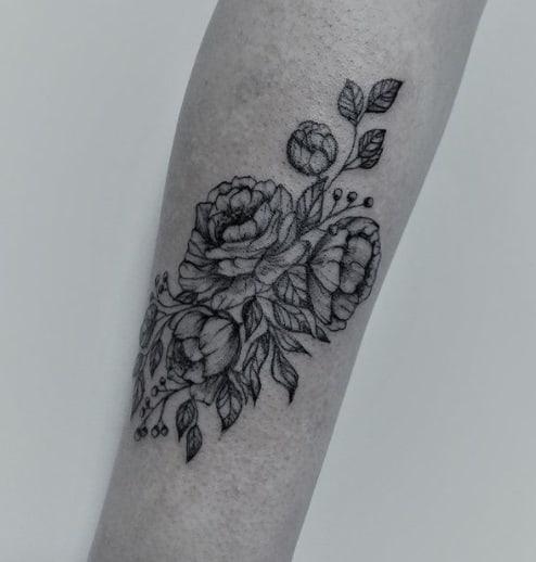 flowers for woman forearm tattoo idea