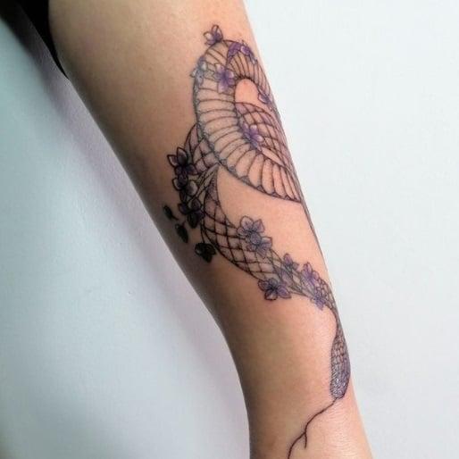snake forearm tattoo idea