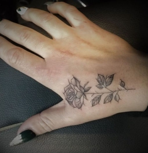 tattoo on hand for woman rose