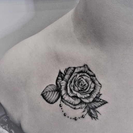 rose for woman shoulder tattoo