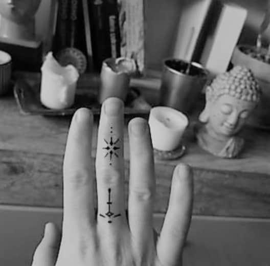 black ink tattoo on hand