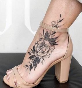 big design tattoo on foot