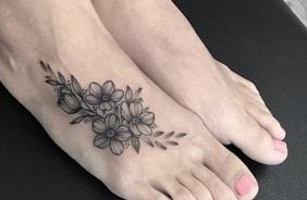 flowers tattoo on foot idea