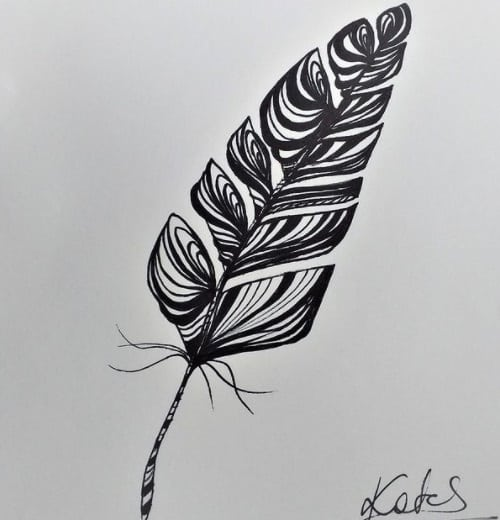 feather tattoo on ribs design