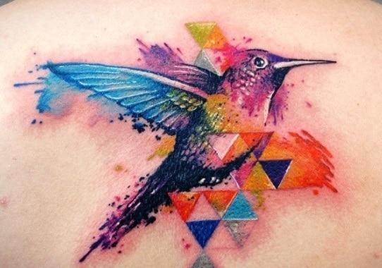 bird on back watercolour tattoo