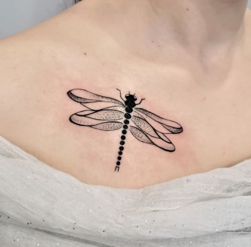 on the collarbone dragonfly tattoo