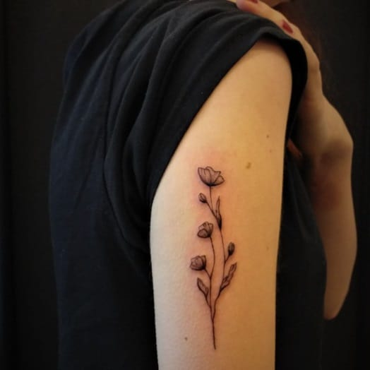 on the back of the arm flower tattoo