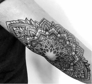 tattoo on the elbow for men mandala