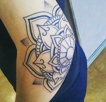 tattoo on the elbow for women mandala