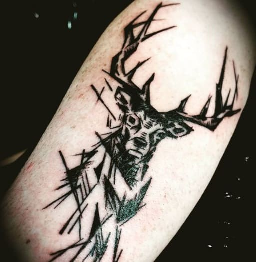 deer head tattoo on arm