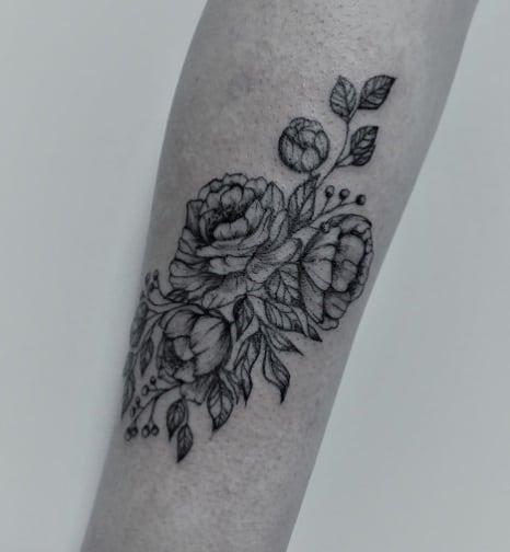 flowers tattoo on arm
