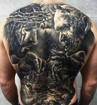 for men religion tattoo on the back