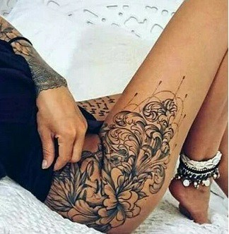 delicate flowers tattoo on the hip for women