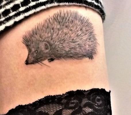 hedgehog tattoo on thigh for women