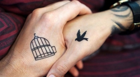 small and still visible matching hand tattoos